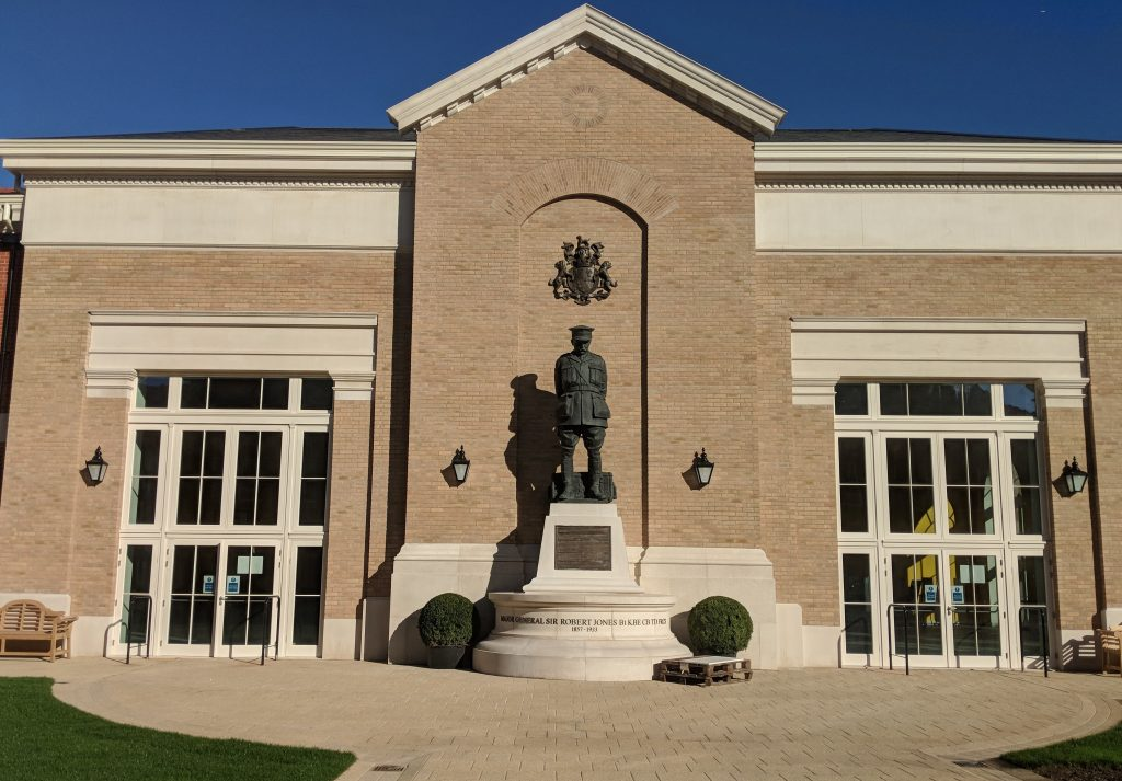 Statue of Sir Robert Jones and the front of a building in Stanford Hall