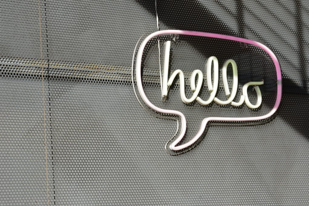 'Hello' sign on a wall